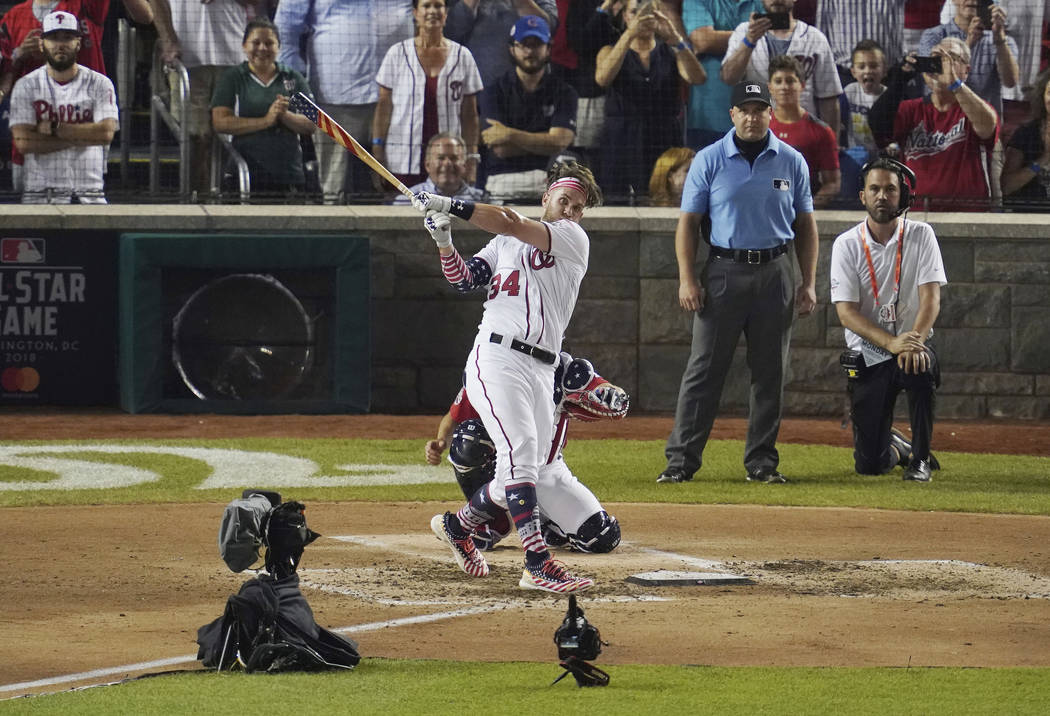 Washington Nationals Bryce Harper hits the winning home run during the Major League Baseball Home Run Derby, Monday, July 16, 2018 in Washington. The 89th MLB baseball All-Star Game will be played ...