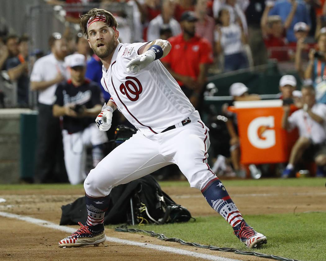 Washington Nationals Bryce Harper celebrates his winning hit during the Major League Baseball Home Run Derby, Monday, July 16, 2018 in Washington. (AP Photo/Alex Brandon)