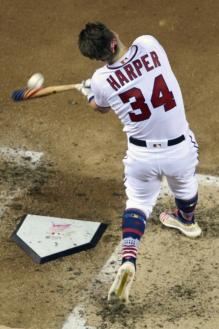 Washington Nationals Bryce Harper (34) hits during the MLB Home Run Derby, at Nationals Park, Monday, July 16, 2018 in Washington. The 89th MLB baseball All-Star Game will be played Tuesday. (AP P ...