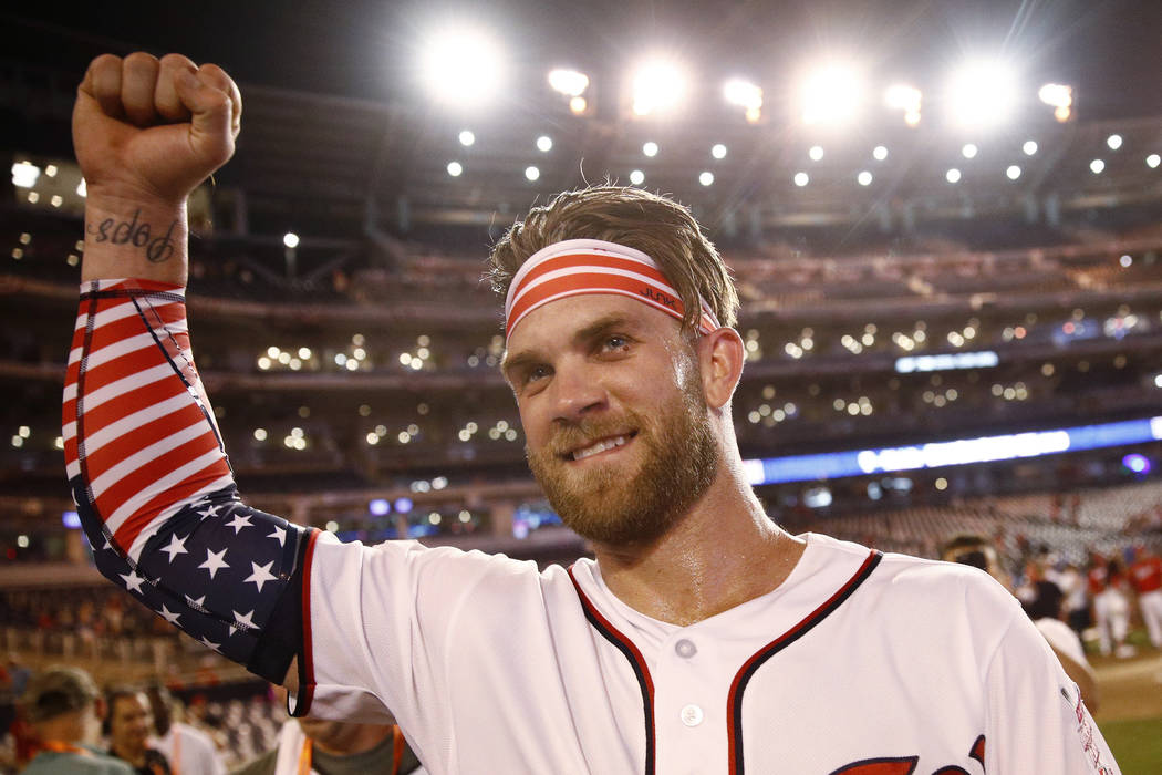Washington Nationals Bryce Harper celebrates his winning hit after the Major League Baseball Home Run Derby, Monday, July 16, 2018 in Washington.(AP Photo/Patrick Semansky)
