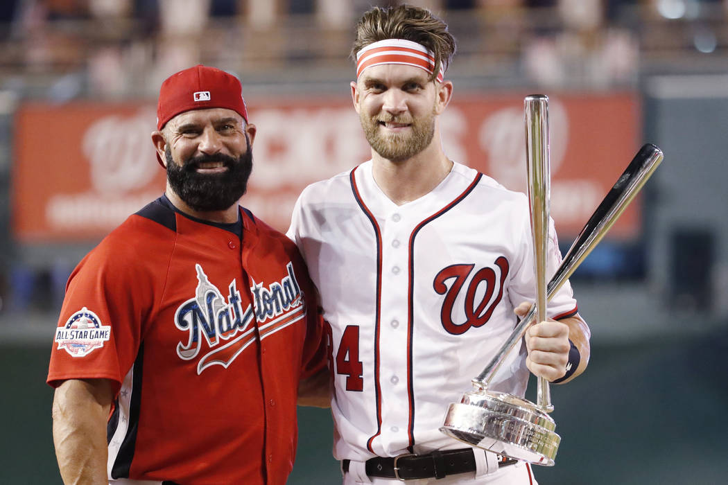 Washington Nationals Bryce Harper stands with his father Ron Harper after Bryce won the Major League Baseball Home Run Derby, Monday, July 16, 2018 in Washington. The 89th MLB baseball All-Star Ga ...