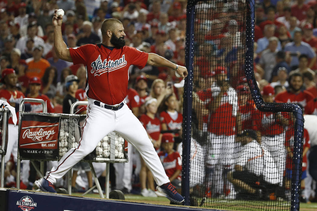 Ron Harper pitches to his son Washington Nationals Bryce Harper during the MLB Home Run Derby, at Nationals Park, Monday, July 16, 2018 in Washington. The 89th MLB baseball All-Star Game will be p ...
