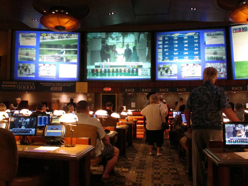 Bettors wait to make wagers on sporting events at the Borgata casino in Atlantic City, N.J., hours after it began accepting sports bets on June 14. New Jersey regulators have received five additio ...