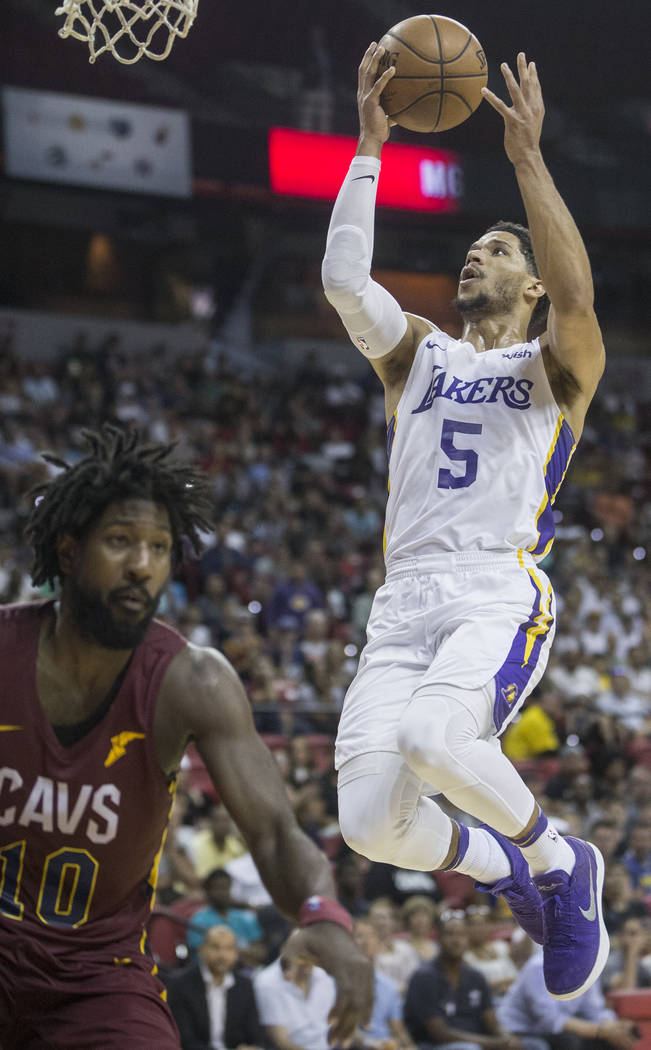 Los Angeles Lakers guard Josh Hart (5) converts a fast break layup over Cleveland Cavaliers guard John Holland (10) in the third quarter during the NBA Summer League semifinals on Monday, July 16, ...