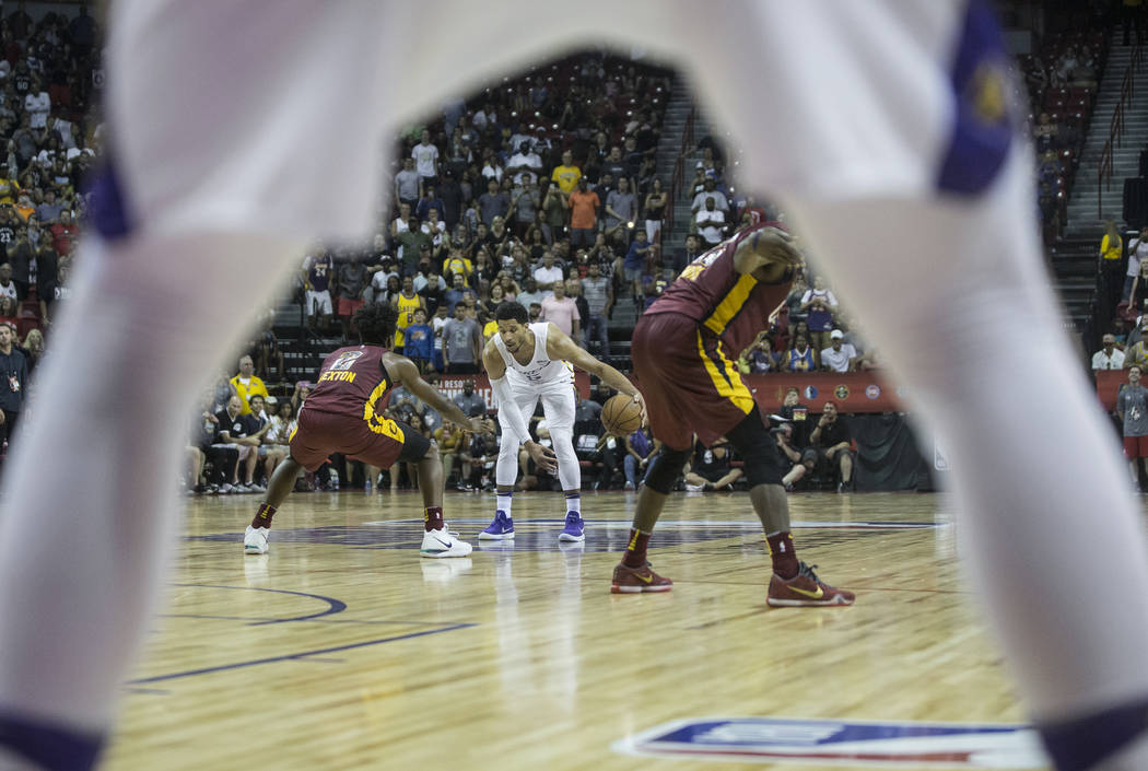 Los Angeles Lakers guard Josh Hart (5) is defended by Cleveland Cavaliers guard Collin Sexton (2) in the fourth quarter during the NBA Summer League semifinals on Monday, July 16, 2018, at the Tho ...