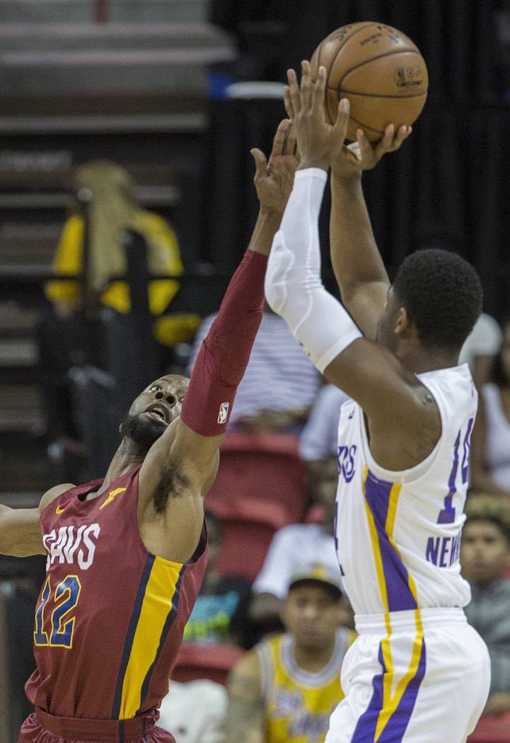 Cleveland Cavaliers guard Scoochie Smith (12) defends Los Angeles Lakers guard Malik Newman (14) in the first quarter during the NBA Summer League semifinals on Monday, July 16, 2018, at the Thoma ...