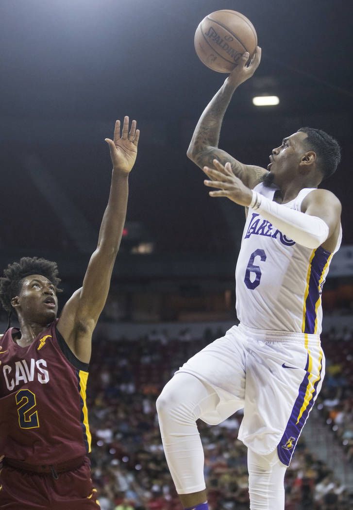 Los Angeles Lakers guard Xavier Rathan-Mayes (6) shoots over Cleveland Cavaliers guard Collin Sexton (2) in the third quarter during the NBA Summer League semifinals on Monday, July 16, 2018, at t ...