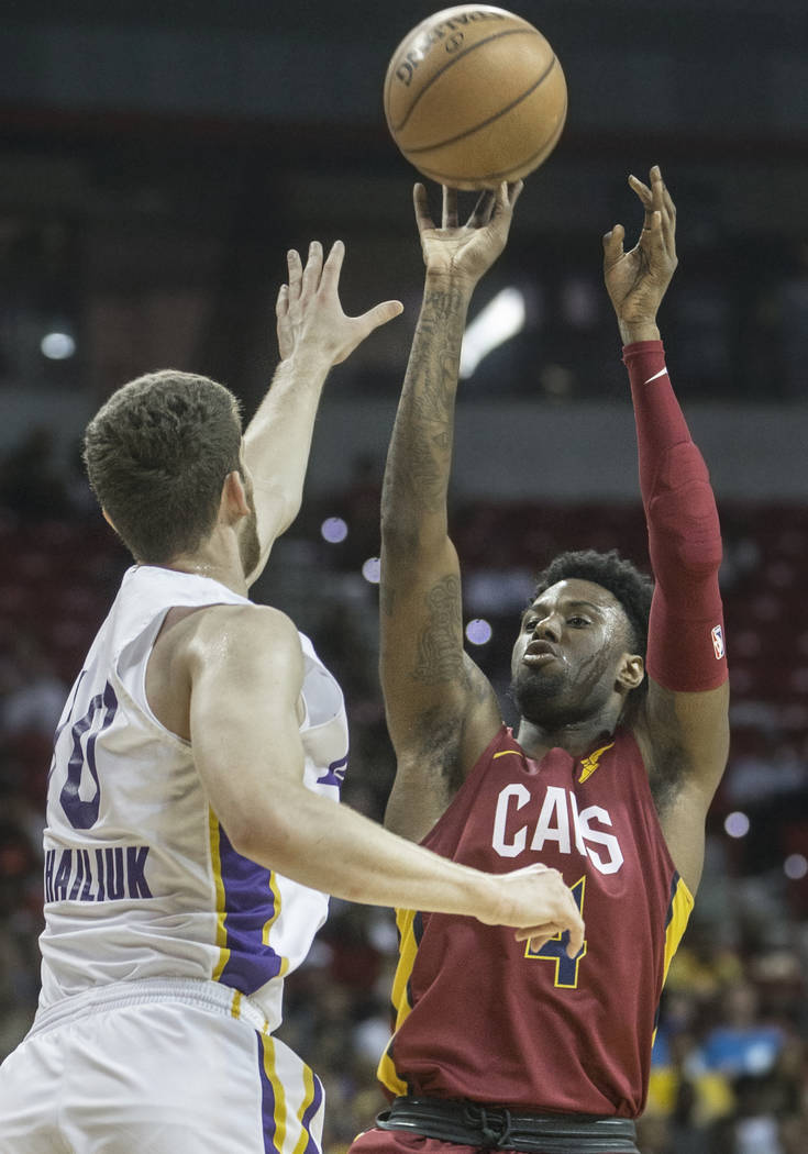 Cleveland Cavaliers forward Jamel Artis (4) shoots over Los Angeles Lakers forward Sviatoslav Mykhailiuk (10) in the first quarter during the NBA Summer League semifinals on Monday, July 16, 2018, ...