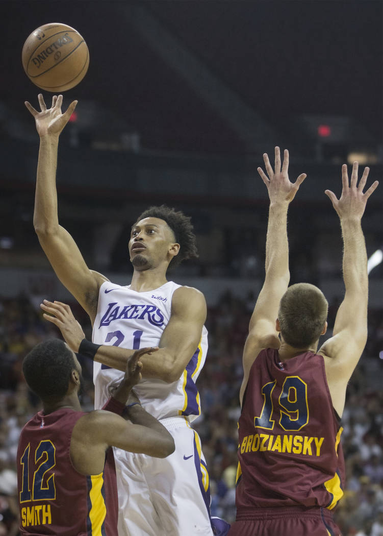 Los Angeles Lakers forward Jonathan Williams (21) shoots over Cleveland Cavaliers defenders Scoochie Smith (12) and Vladimir Brodziansky (19) in overtime during the NBA Summer League semifinals on ...