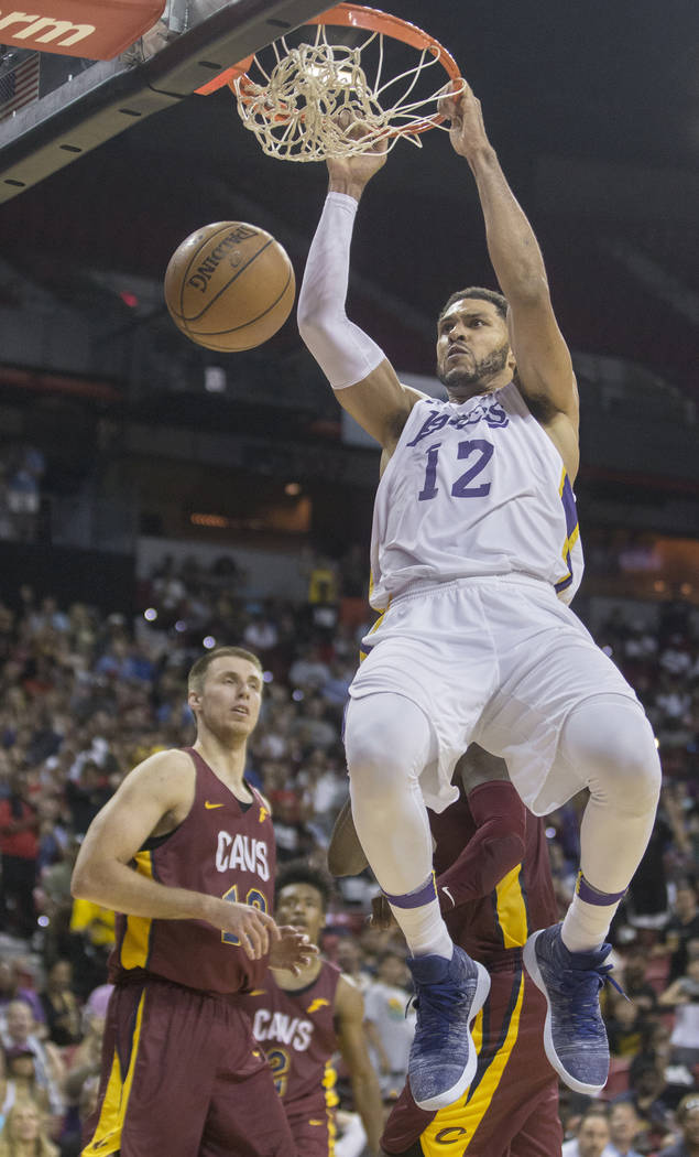 Los Angeles Lakers forward Jeff Ayres (12) dunks over Cleveland Cavaliers forward Vladimir Brodziansky (19) in overtime during the NBA Summer League semifinals on Monday, July 16, 2018, at the Tho ...