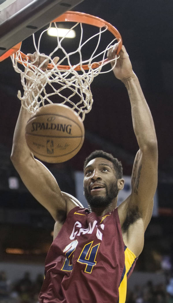Cavaliers center Marcus Lee (24) dunks in the first quarter during Cleveland's NBA Summer League semifinals game with the Los Angeles Lakers on Monday, July 16, 2018, at the Thomas & Mack Cent ...