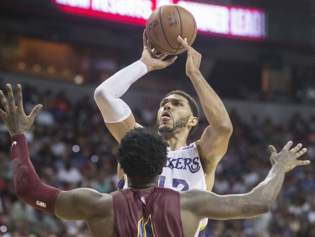 Los Angeles Lakers forward Jeff Ayres (12) shoots over Cleveland Cavaliers forward Jamel Artis (4) in the fourth quarter during the NBA Summer League semifinals on Monday, July 16, 2018, at the Th ...