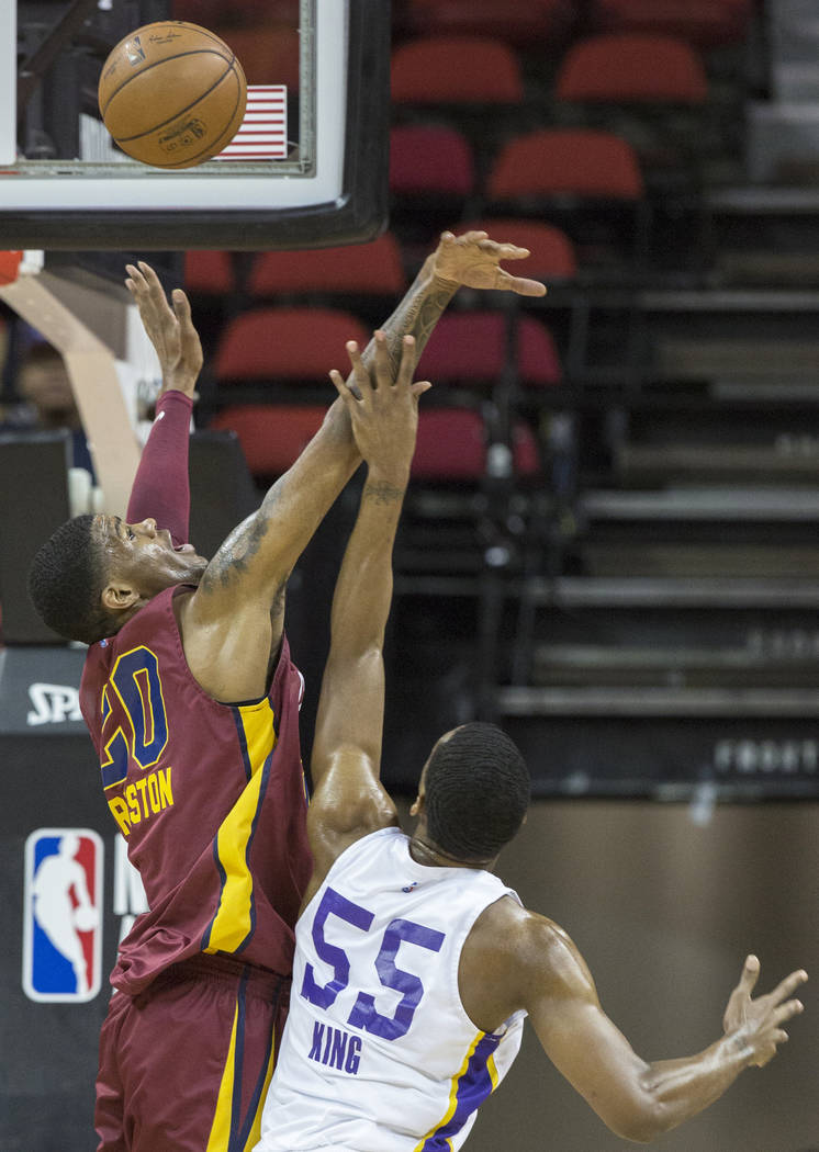 Cleveland Cavaliers forward Billy Preston (20) blocks the shot of Los Angeles Lakers guard Nick King (55) in the first quarter during the NBA Summer League semifinals on Monday, July 16, 2018, at ...