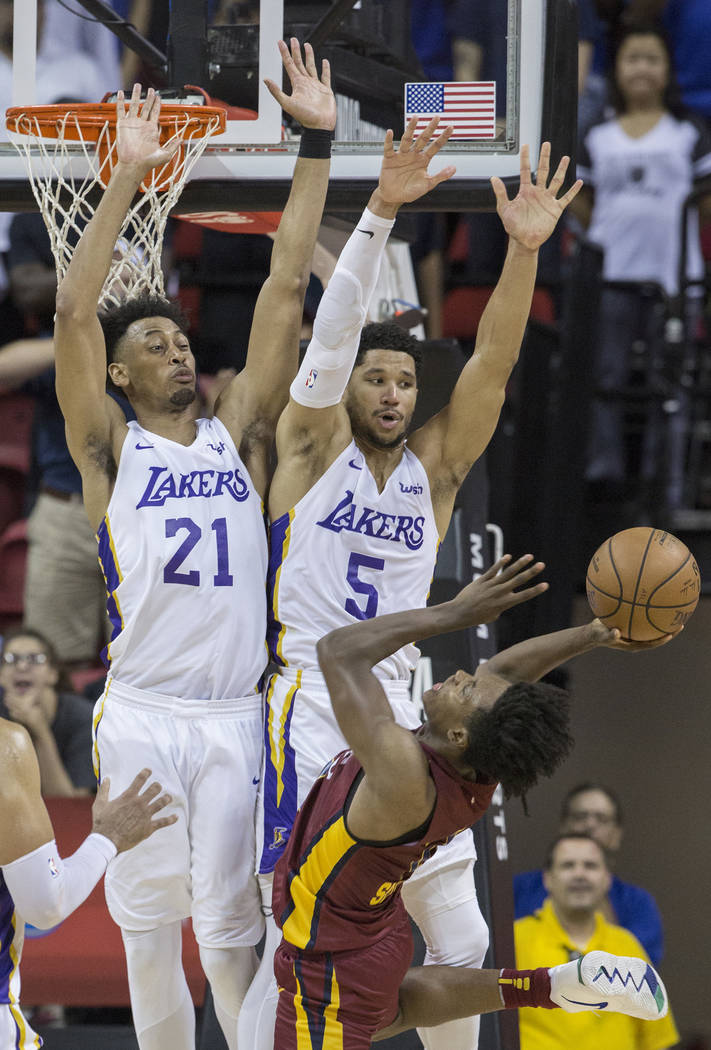 Los Angeles Lakers defenders Jonathan Williams (21) and Josh Hart (5) defend Cleveland Cavaliers guard Collin Sexton (2) in the fourth quarter during the NBA Summer League semifinals on Monday, Ju ...