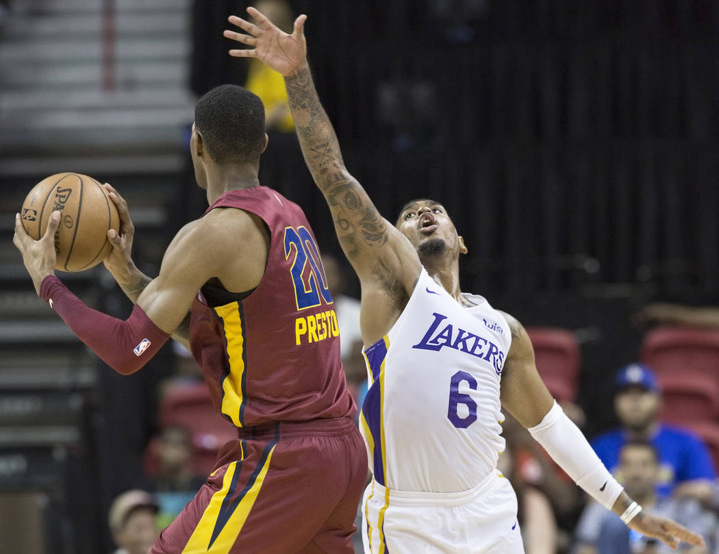 Los Angeles Lakers guard Xavier Rathan-Mayes (6) defends Cleveland Cavaliers forward Billy Preston (20) in the fourth quarter during the NBA Summer League semifinals on Monday, July 16, 2018, at t ...
