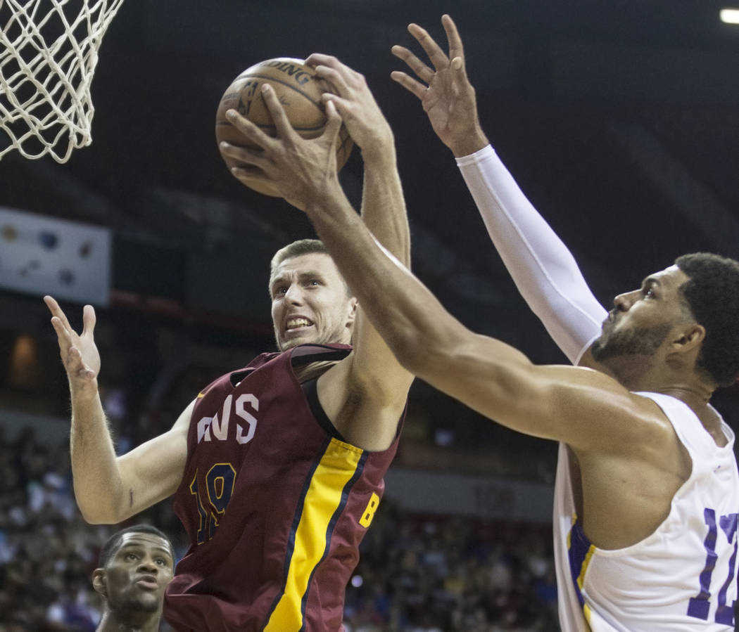 Cleveland Cavaliers forward Vladimir Brodziansky (19) fights for a rebound with Los Angeles Lakers forward Jeff Ayres (12) in the third quarter during the NBA Summer League semifinals on Monday, J ...
