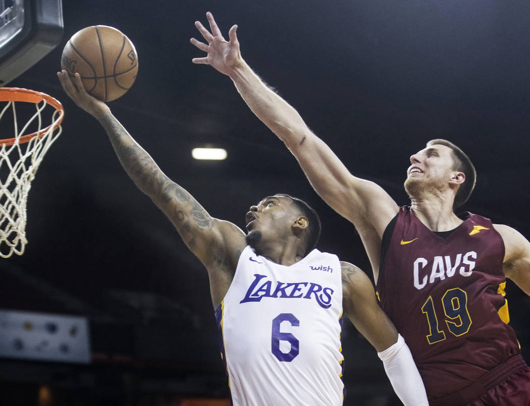 Los Angeles Lakers guard Xavier Rathan-Mayes (6) drives past Cleveland Cavaliers forward Vladimir Brodziansky (19) in overtime during the NBA Summer League semifinals on Monday, July 16, 2018, at ...