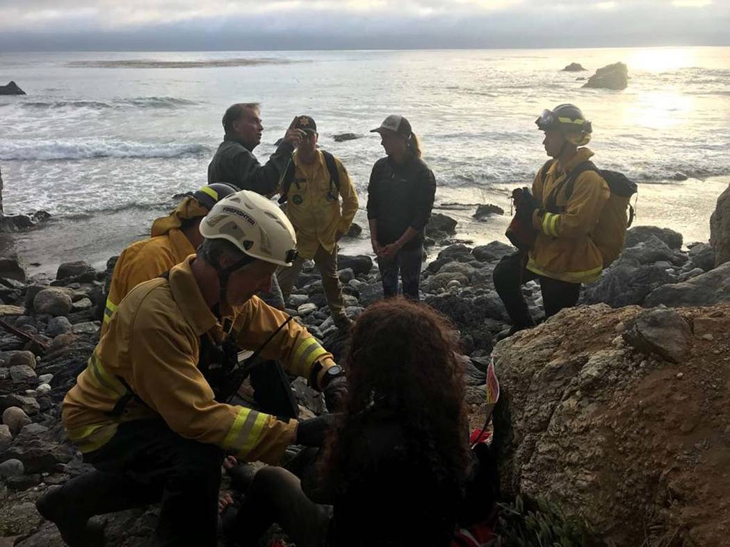 In this Friday, July 13, 2018, photo posted on the Monterey County, Calif., Sheriff's Office Twitter feed, authorities tend to Angela Hernandez, foreground center, after she was rescued, in Morro ...