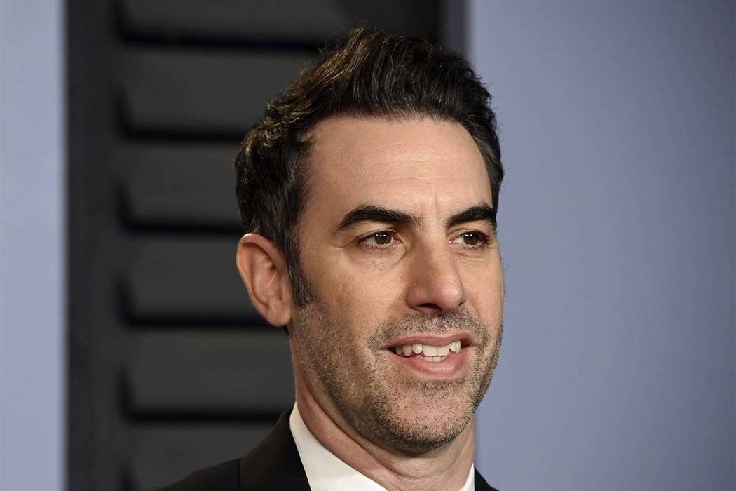 "n this March 4, 2018 file photo, Sacha Baron Cohen arrives at the Vanity Fair Oscar Party in Beverly Hills, California. Cohen stars in the new Showtime series ""Who Is America?"" (Evan Agostini/Invi ..."