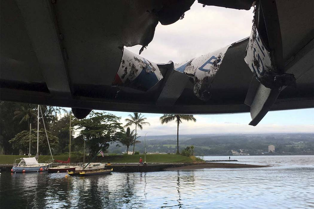 This photo provided by the Hawaii Department of Land and Natural Resources shows damage to the roof of a tour boat after an explosion sent lava flying through the roof off the Big Island of Hawaii ...