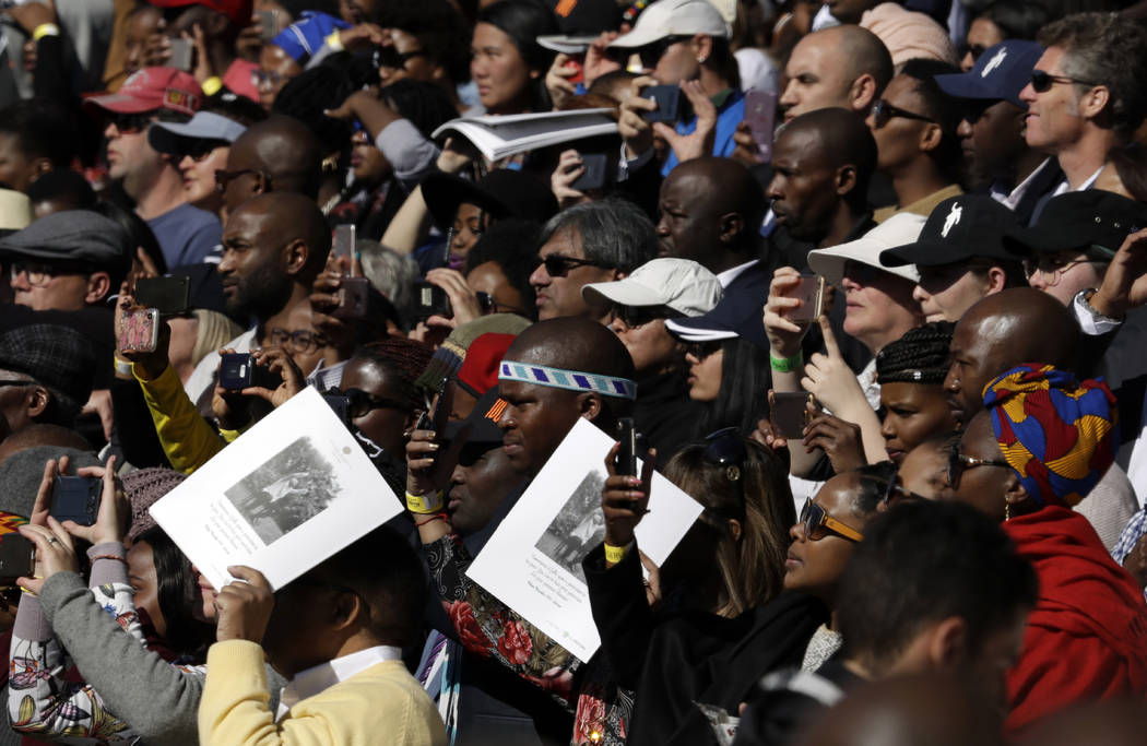 Crowds attend the 16th Annual Nelson Mandela Lecture at the Wanderers Stadium in Johannesburg, South Africa, Tuesday, July 17, 2018 where former President Barack Obama was to deliver the 16th Annu ...