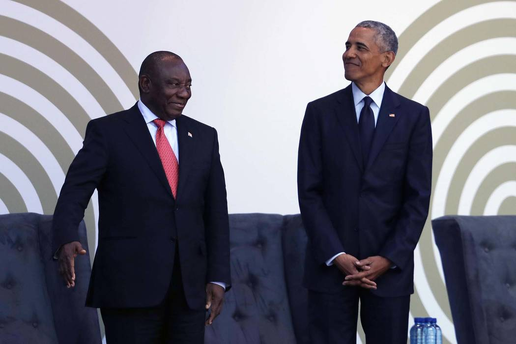 Former President Barack Obama, right, stands with President Cyril Ramaphosa as Obama arrives at the Wanderers Stadium in Johannesburg, South Africa, Tuesday, July 17, 2018 to deliver the 16th Ann ...
