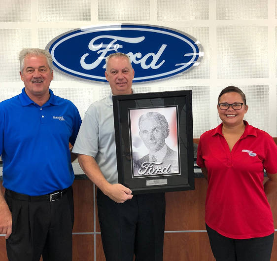 Longtime Friendly Ford service adviser Paul Deems, center, is congratulated by service director Greg Haas and assistant service manager Michelle Ochoa for being named the 2017 Employee Excellence ...
