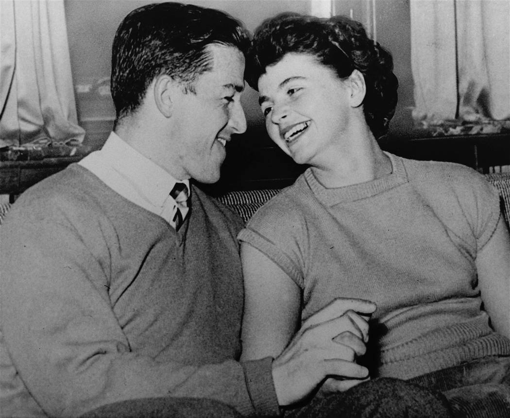 Olympic champions Harold Connolly and his bride, the former Olga Fikotova of Czechoslovakia, wear that honeymoon look on arrival in Vienna, Austria. Connolly, U.S. hammer throw champion from Bosto ...