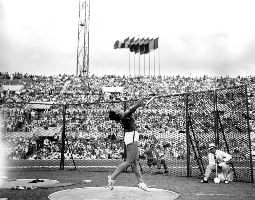Olga Connolly, the former Olga Fikotova of Czechoslovakia, throws the discus during the Olympic games at the Stadio Olympico in Rome, Italy on Sept. 5, 1960. (AP Photo)
