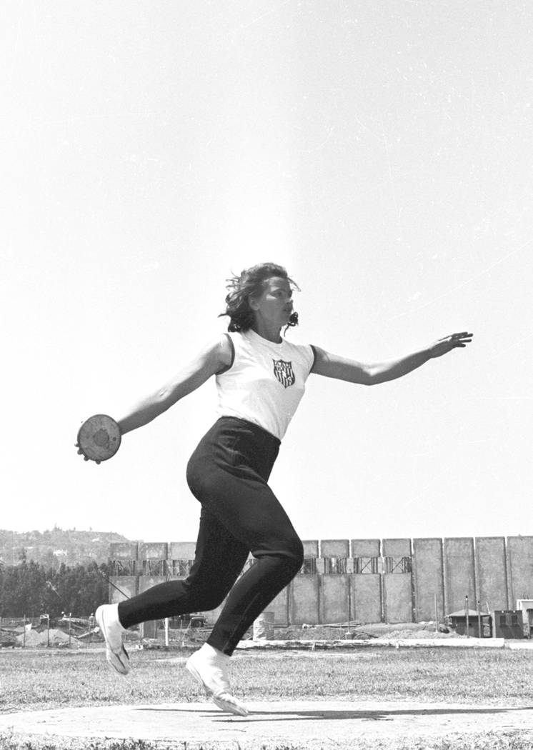 Olga Connolly, the former Olga Fikotova of Czechoslovakia, practices with the discuss at the UCLA Athletic Field in Los Angeles, Ca. on July 15, 1964. Olga Fikotova won the gold at the 1956 Olymp ...
