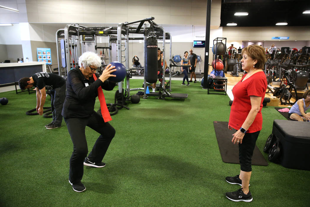 Fitness coach Olga Connolly, left, 85, works with Priscilla Whitt at the EoS Fitness gym, 7070 S Durango Drive, in Las Vegas, Wednesday, July 18, 2018. Connolly is a former Olympian who won a gold ...