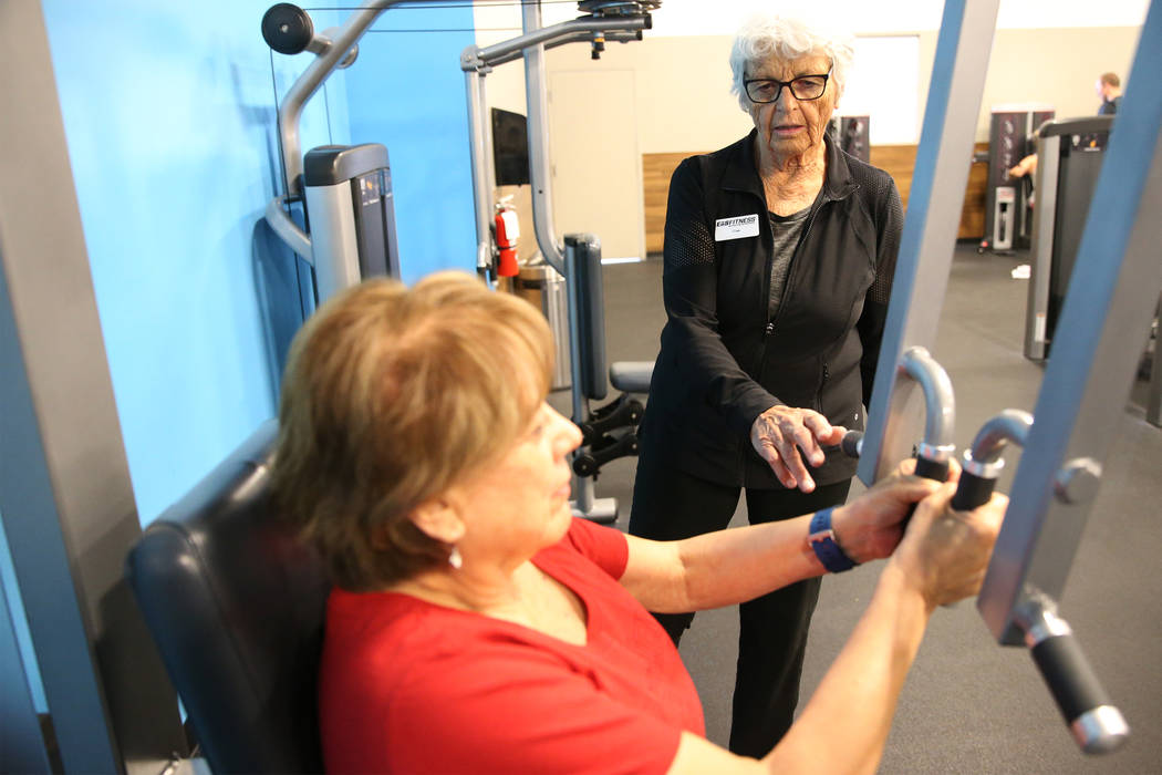 Fitness coach Olga Connolly, right, 85, works with Priscilla Whitt at the EoS Fitness gym, 7070 S Durango Drive, in Las Vegas, Wednesday, July 18, 2018. Connolly is a former Olympian who won a gol ...