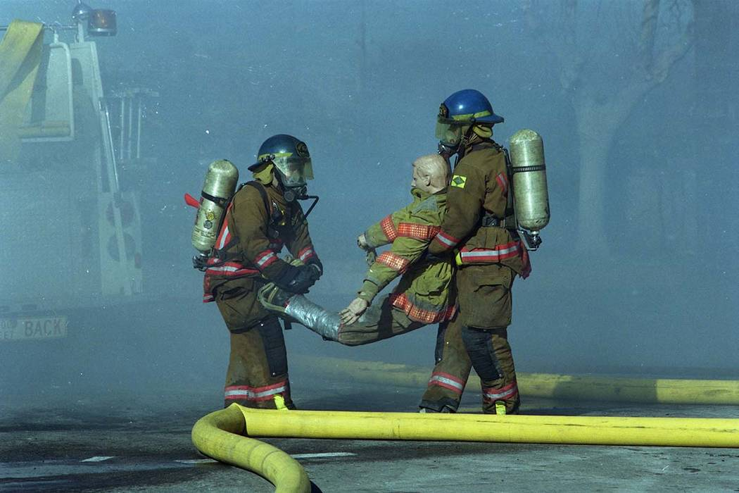 Firefighters train during a fire safety demonstration at the Las Vegas Fire Department Fire Training Center 633 North Mojave Road at East Bonanza Road in this February, 1999, photo. (Las Vegas Rev ...