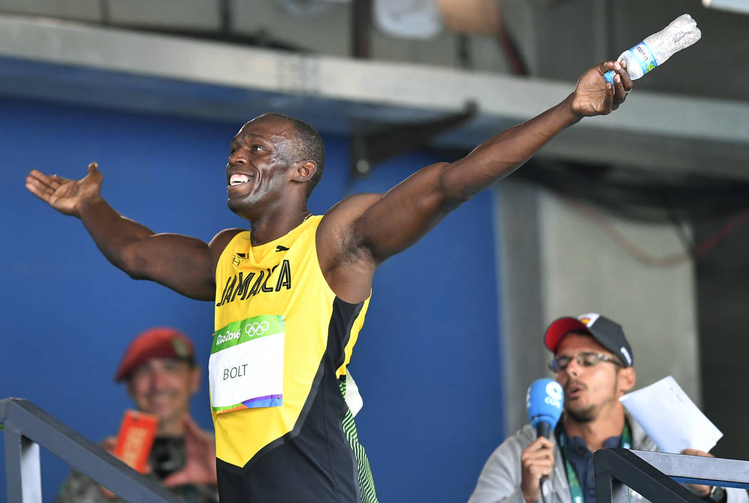 Jamaica's Usain Bolt celebrates after winning a men's 100-meter heat at the Olympic stadium in Rio de Janeiro, Brazil, Saturday, Aug. 13, 2016. (Martin Meissner/The Associated Press)