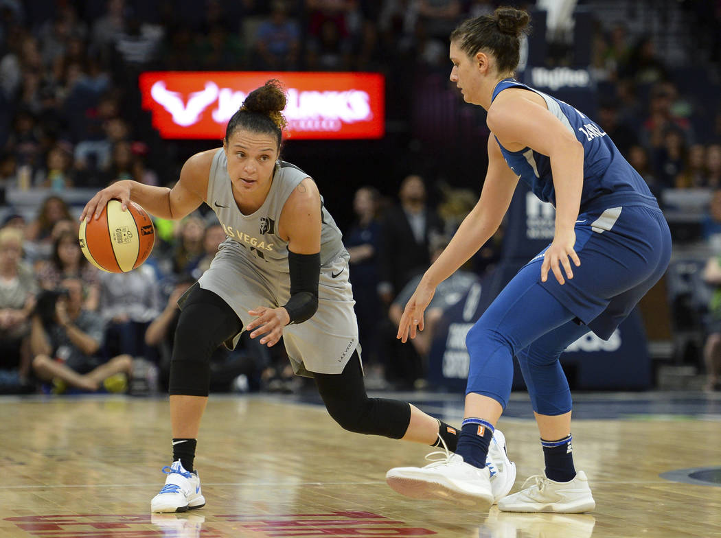 Las Vegas Aces guard Kayla McBride drives against Minnesota Lynx forward Cecilia Zandalasini (9) during the second half of a WNBA basketball game Friday, July 13, 2018, in Minneapolis. (Aaron Lavi ...