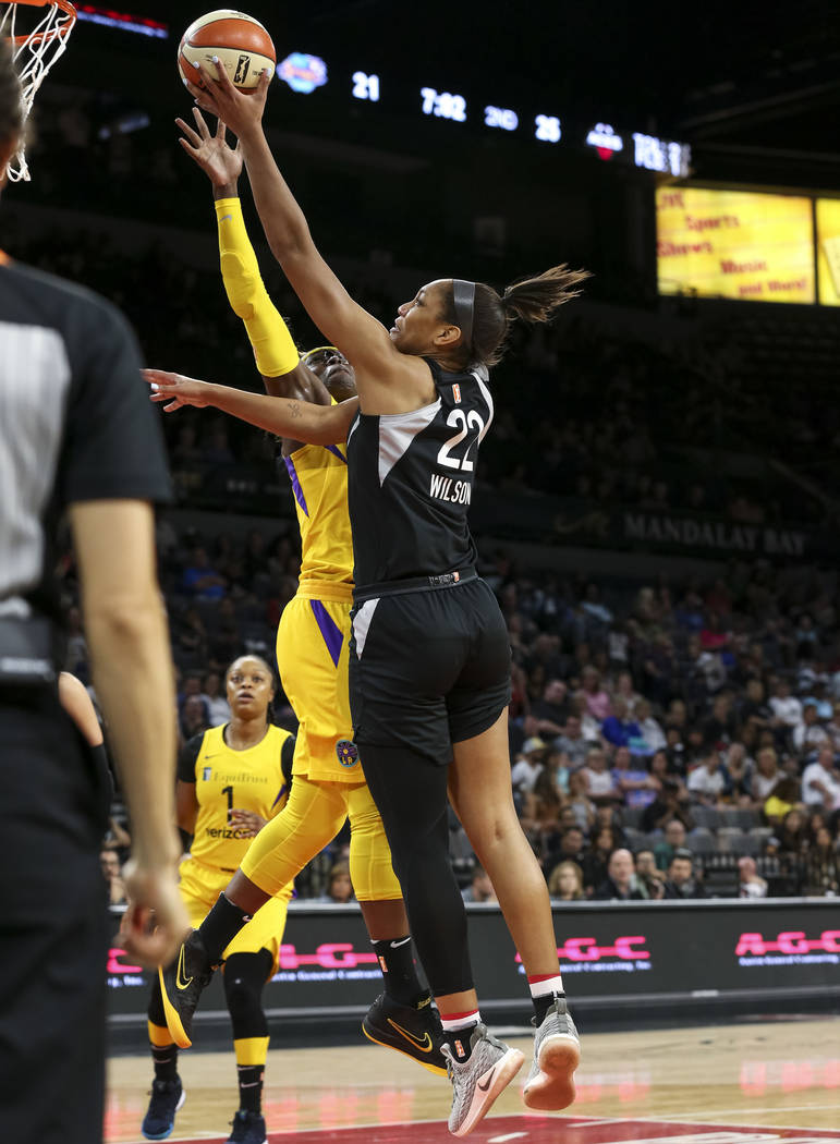 Las Vegas Aces center A'ja Wilson (22) goes up for a shot against Los Angeles Sparks forward Essence Carson (17) during the first half of a WNBA basketball game at the Mandalay Bay Events Center i ...