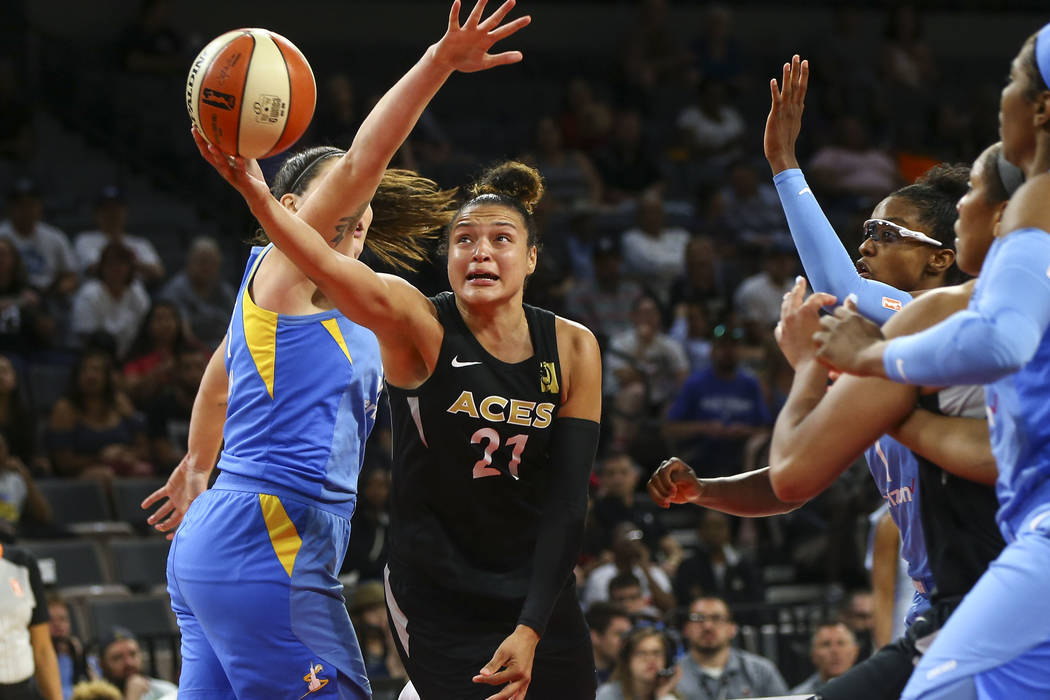Las Vegas Aces guard Kayla McBride (21) sends up a shot past Chicago Sky center Stefanie Dolson (31) during the second half of a WNBA basketball game at Mandalay Bay Events Center in Las Vegas on ...
