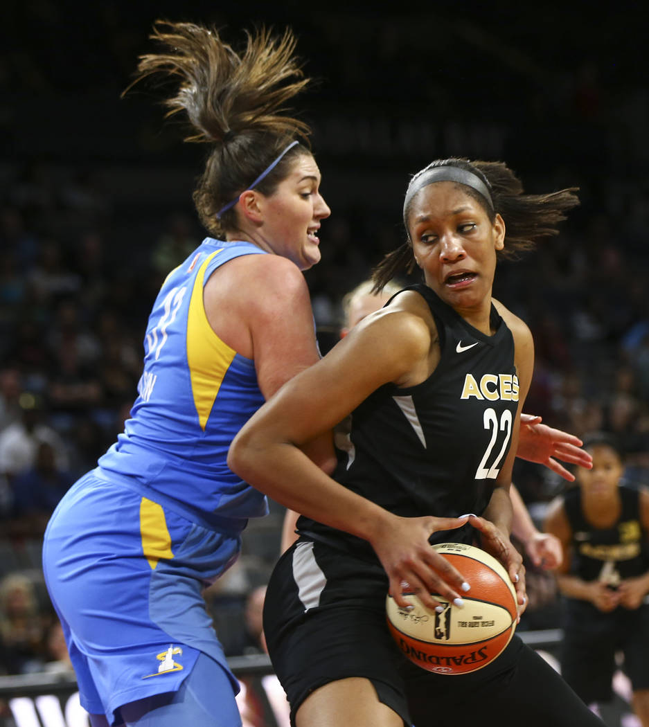 Las Vegas Aces center A'ja Wilson (22) drives against Chicago Sky center Stefanie Dolson (31) during the second half of a WNBA basketball game at Mandalay Bay Events Center in Las Vegas on Thursda ...
