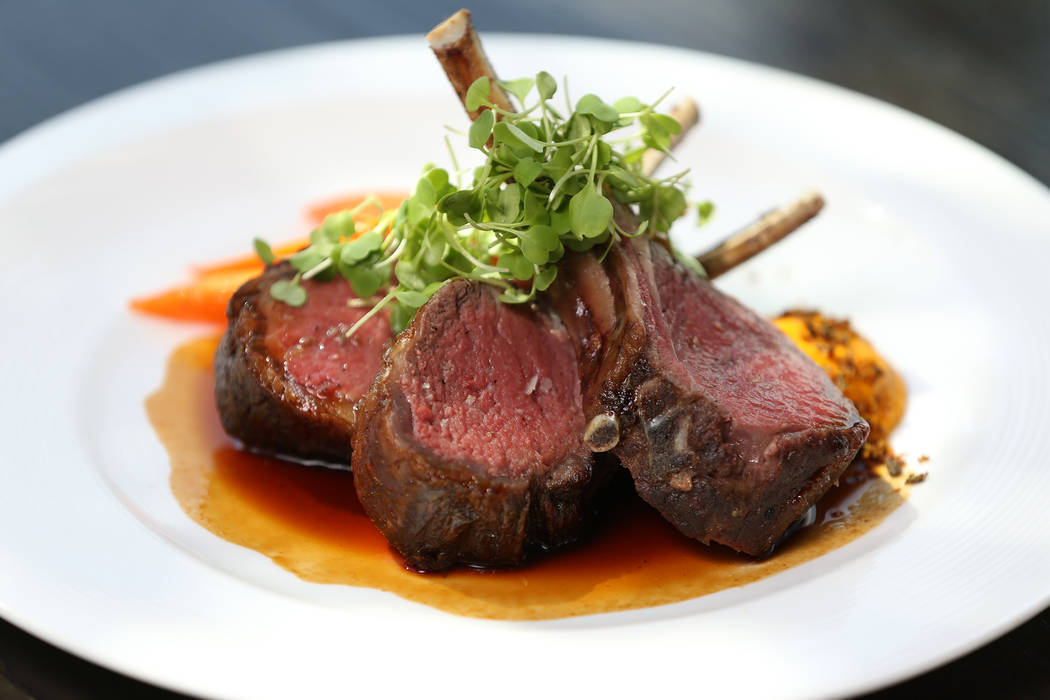 The roasted rack of lamb is served with vadouvan carrots, bloomsdale spinach and harissa lamb jus, at Gordon Ramsay Hell's Kitchen in Las Vegas, Tuesday, July 17, 2018. Erik Verduzco Las Vegas Rev ...
