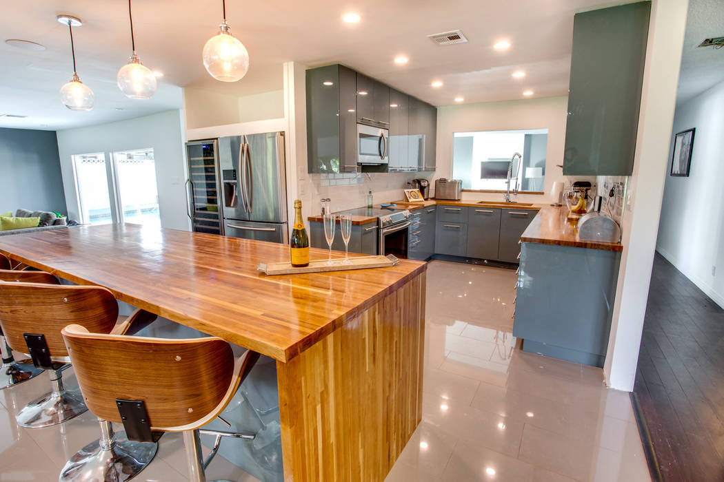 AFTER: The updated kitchen has custom cabinets, cherry wood counters, new appliances and a 160-bottle wine refrigerator. (Sarah Gascoine Stellar Focus)