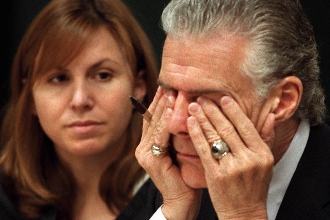 John Momot rubs his eyes as his client Sandra Murphy glances over while Judge Joseph Bonaventure discusses Murphy's house arrest in 2001. (Jeff Scheid/Las Vegas Review-Journal)