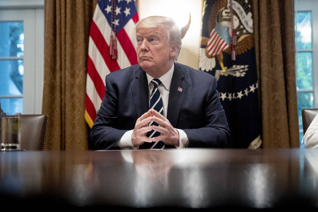 President Donald Trump waits for members of the media get set up before speaking in the Cabinet room of the White House, Tuesday, July 17, 2018, in Washington. Trump says he meant the opposite whe ...