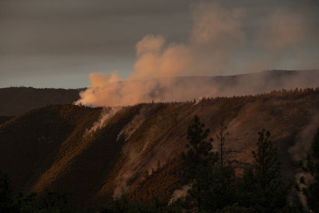 The Ferguson Fire burns along a ridgeline in unincorporated Mariposa County, Calif, on Monday, July 16, 2018. (AP Photo/Noah Berger)