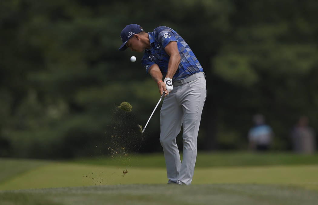Rickie Fowler hits on the seventh hole during the second round of the Quicken Loans National golf tournament, Friday, June 29, 2018, in Potomac, Md. (AP Photo/Nick Wass)