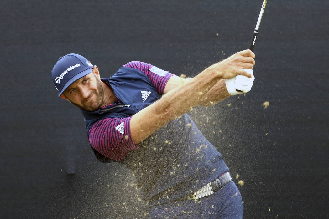 U.S. golfer Dustin Johnson tees off on the 16th par 3 during a practice round for the 147th Open golf Championship at Carnoustie golf club, Scotland, Monday July 16, 2018. (AP Photo/Peter Morrison)