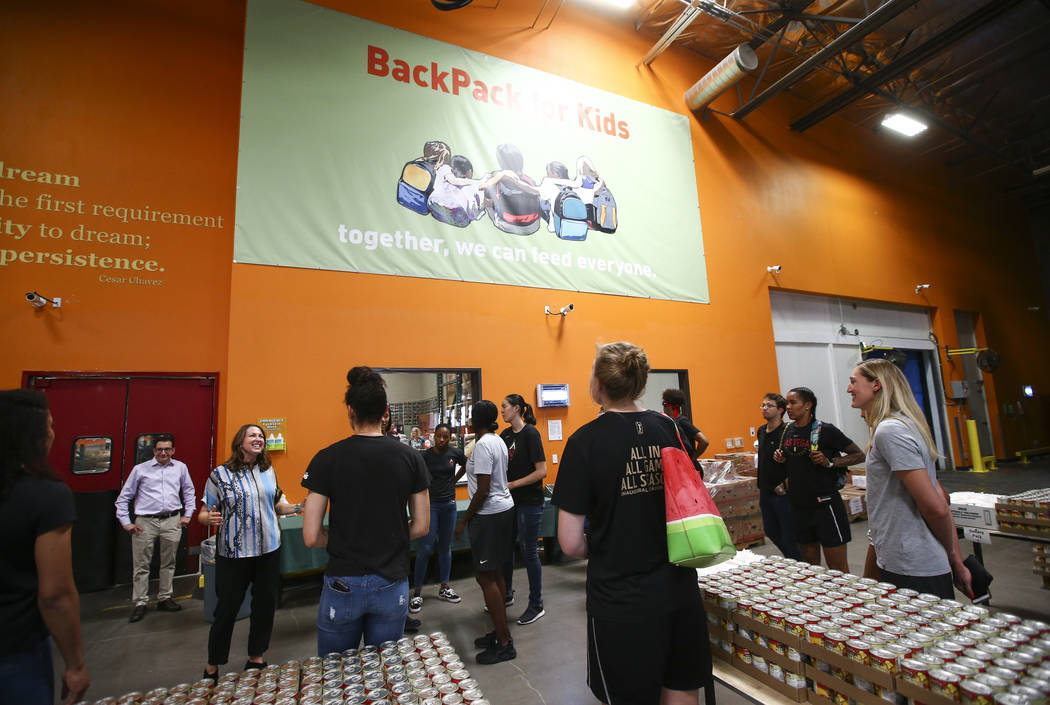 Players and staff of the Las Vegas Aces tour the Three Square food bank before packaging food for people in need in Las Vegas on Tuesday, July 17, 2018. Chase Stevens Las Vegas Review-Journal @css ...
