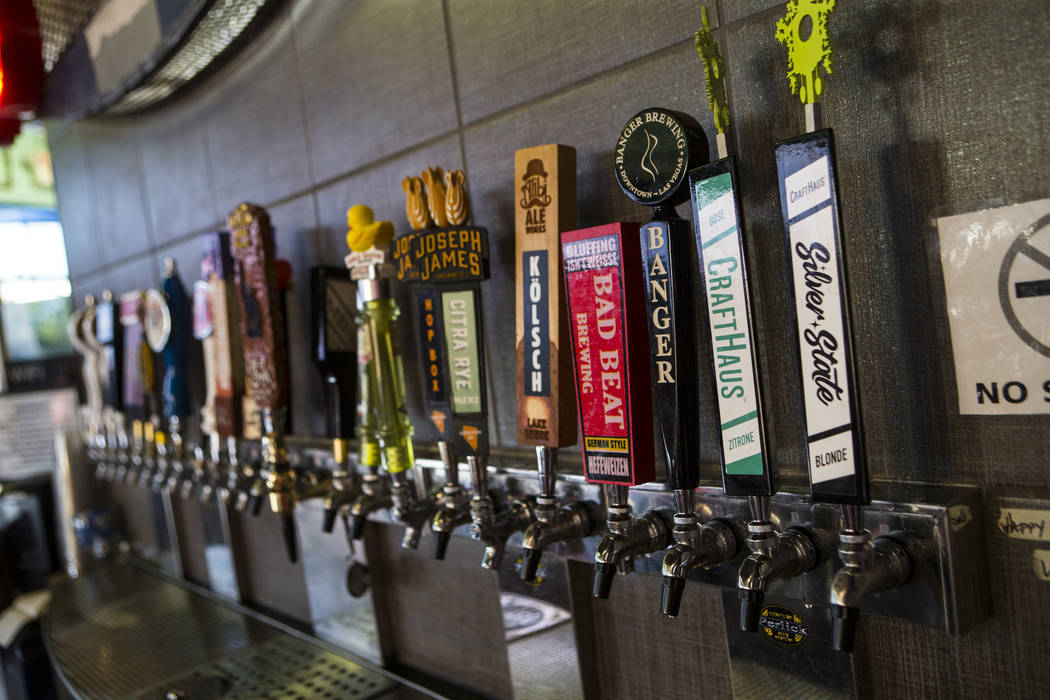 Beer taps at Nevada Taste Site on Main Street in downtown Las Vegas' arts district on Thursday, July 19, 2018. Chase Stevens Las Vegas Review-Journal @csstevensphoto