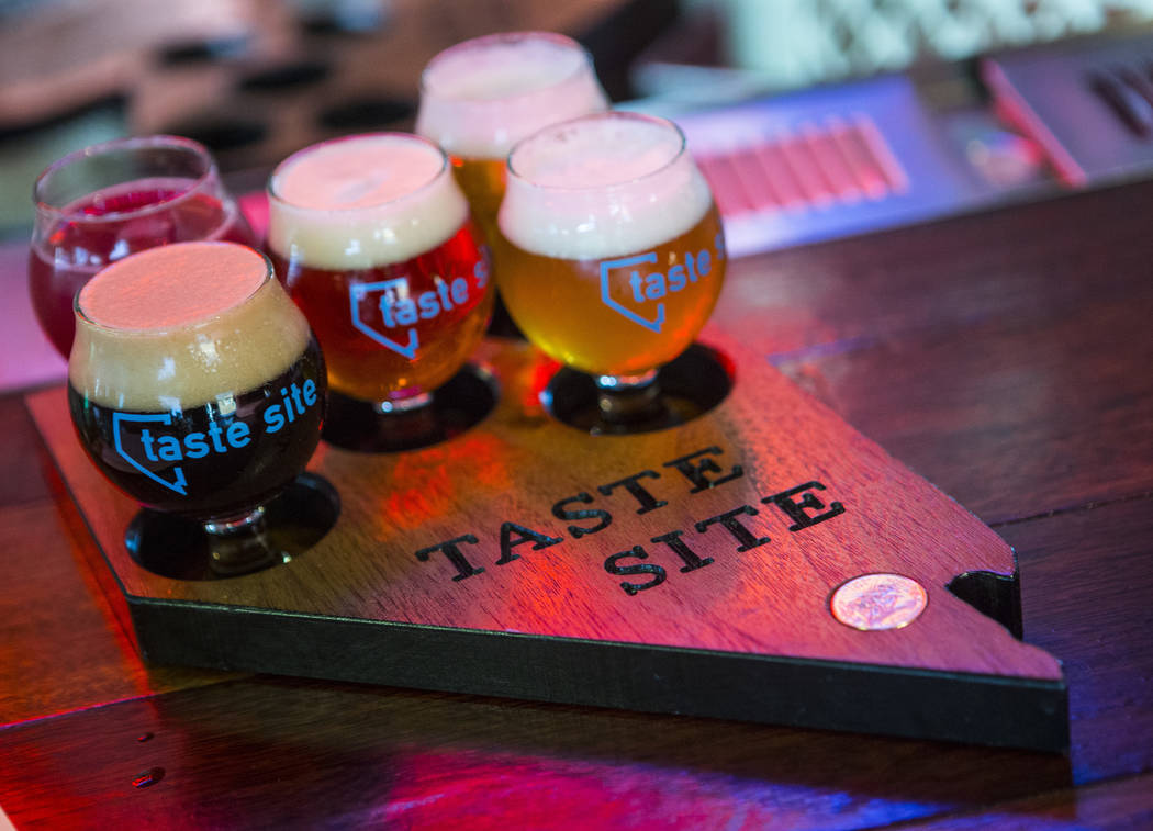 A flight of beer is presented on a tray shaped like the state of Nevada at Nevada Taste Site on Main Street in downtown Las Vegas' arts district on Thursday, July 19, 2018. Chase Stevens Las Vegas ...