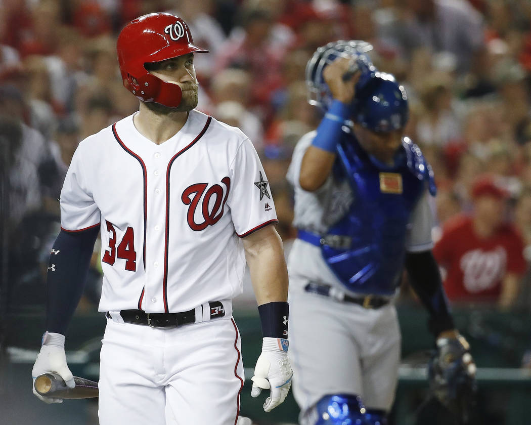 Washington Nationals outfielder Bryce Harper (34) walks off the field after striking out in the fourth inning of the Major League Baseball All-star Game, Tuesday, July 17, 2018 in Washington. (AP ...