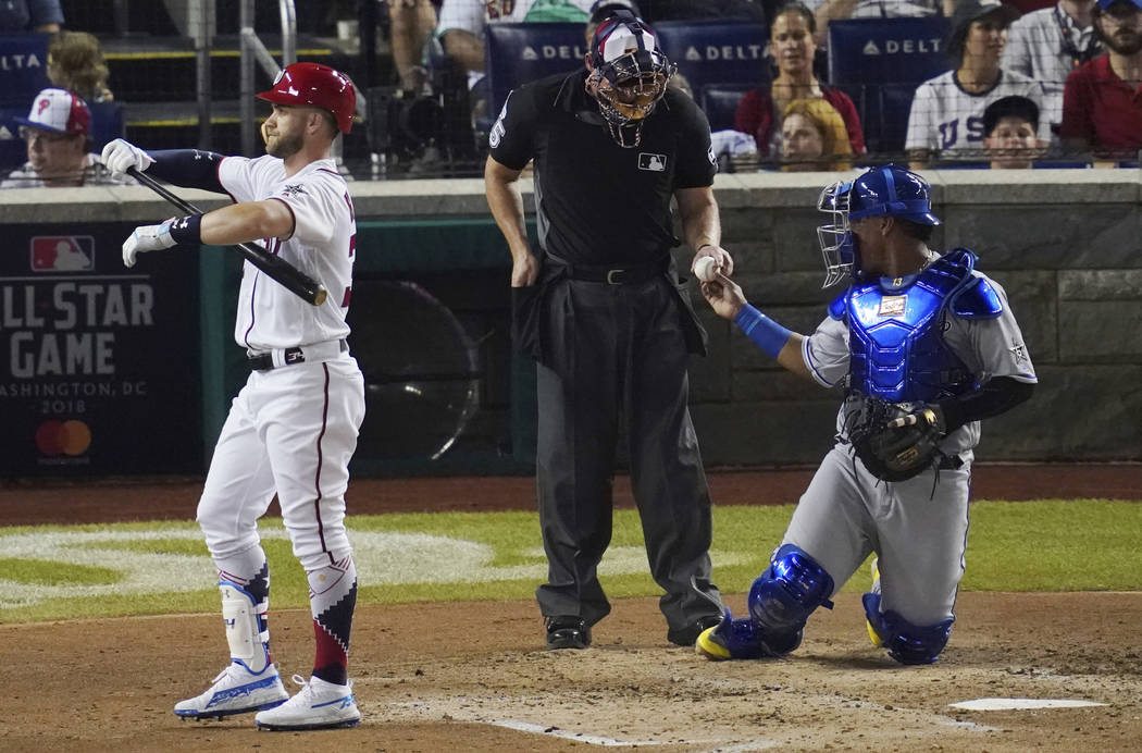 Washington Nationals Bryce Harper walks off the field after striking out in the fourth inning of the Major League Baseball All-star Game, Tuesday, July 17, 2018 in Washington. (AP Photo/Carolyn Ka ...